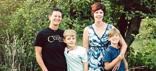 Charlie Spencer (second from the right) with her partner Becky Scott and their sons Jude and Henry.
